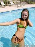 Sexy teen gets all wet in the swimming pool