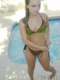 Amateur teen hottie spreads her pussy poolside