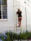 Upskirt shot of blonde teen climbing ladder