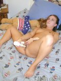 Naughty teen on bed sticks a finger in her ass