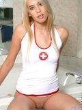 Cutie wears a tight sleek red cross shirt looks like sexy nurses ready to touch