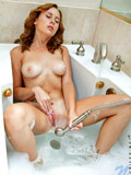 Alluring Nubile Mae Myers pampers her pussy in a refreshing bubble bath
