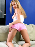 Blonde nymph Magda pinches her tight boobs and flaunts her curvy body on the couch
