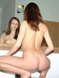 Nude hottie exploring fresh body in the mirror