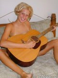 Hot teen gets off playing guitar in the nude