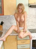 Busty naked milana sitting on kitchen table exposed her yummy assets