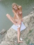 Check out busty milana stretching out her white panty in the lake
