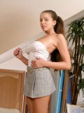 Alluring latin girl gently posing and teasing