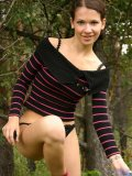 Seriously cute teen nubile nadia pulls off her matching black underwear set outside