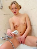 College stunner natalia fully naked on the bath room washes off her pussy