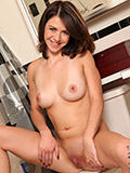 Brunette spinner Nicole Rider slips off her panties to please her shaved pussy