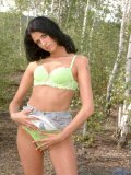 Long black haired ola sitting topless in the woods