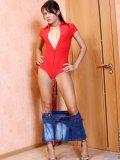 Naked asian teenie exposing her tempting body behind the door