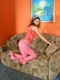Totally naked tatiana displays her smooth perky body on the sofa
