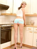 Tosha teasing us eagerly as she gently licks on pink dildo in the kitchen