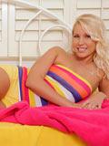 Naughty girl next door plays with her moist pussy in her bedroom