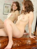 chubby hot nubile flaunting her shaved pussy indoors