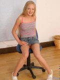 Alluring blonde gets her boobs exposed while inching down her denim skirt