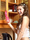 Teen hottie posing in the kitchen