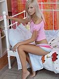 Stunning blonde teen posing naked