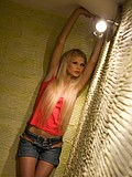 Teen posing in hallway