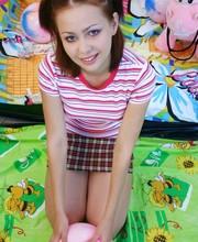Sweet teen cutie rubs her pussy
