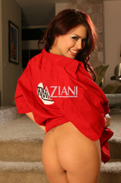 Eva Angelina chose an Aziani work shirt to wear. Do yourself a favor and take your time browsing the full nudes at the end of her photo shoot and get a look at that utterly lickable pussy.