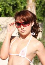 TT girl poses in tiny see thru bikini