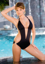 Carli Banks is gorgeous in her sexy black bathing suit�and even hotter out of it!