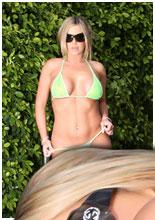 Blonde babe in see thru bikini