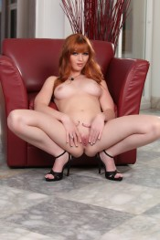 Hot red head shows off her bald pussy.