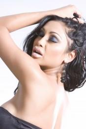 Busty Indian Pornstar, Priya Anjali Rai, heats up the camera in her black bra and panties, thigh high stockings and heels!